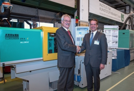 "Arburg built two industrial prototype reciprocating ""inverse screw"" machines based on its electric Allrounder 270A injection molding machine. Arbur's Eduard Duffner presented one to Christian Hopmann, head of the IKV, last March for benchmarking and further R&D."