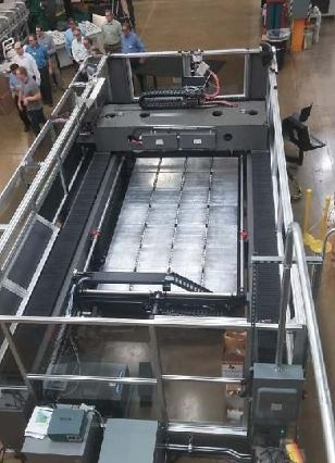 Oak Ridge National Lab took only eight months to convert Cincinnati Inc.'s gantry-style laser cutting machine into the world's first Big Area Additive Manufacturing machine with a build area of 20 x 7 ¾ x 6 feet. At the IMTS 2014 show, it built a concept car during the show.